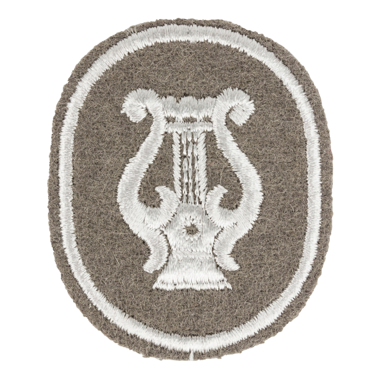 NVA Laufbahnabzeichen Militärmusikdienst grau
